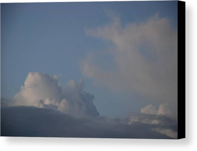 Clouds Canvas Print featuring the photograph Greyskys by Rob Hans