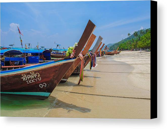 Longtail Boats Canvas Print featuring the photograph Longtails Await by Megan Martens