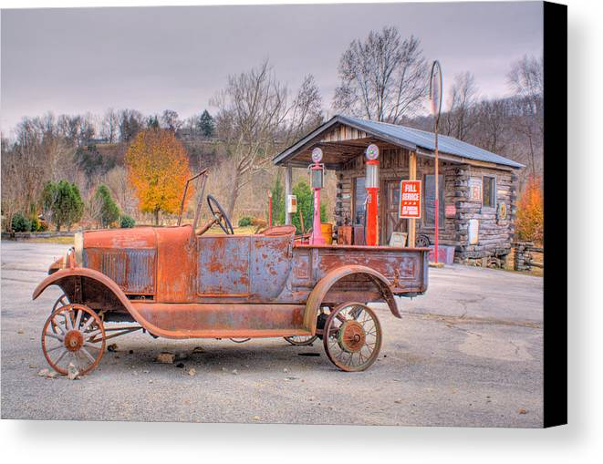 Old Canvas Print featuring the photograph Old Truck And Gas Filling Station by Douglas Barnett