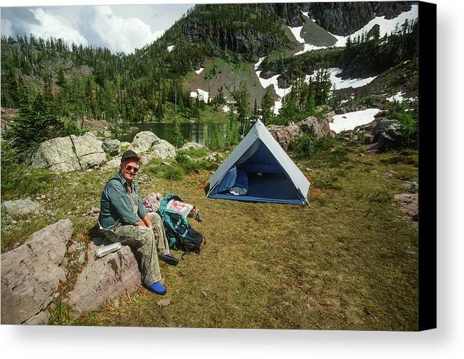 Adventure Canvas Print featuring the photograph Older Man Resting In Backpacking Camp by Jerry Voss