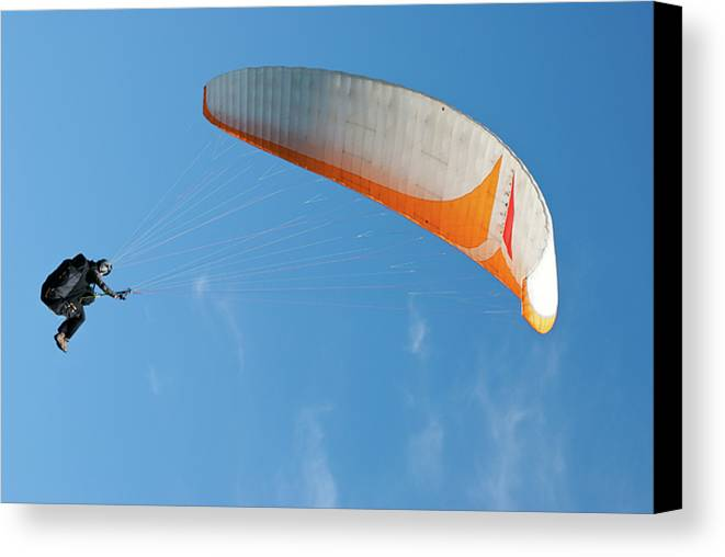 Para-glider Canvas Print featuring the photograph Paraglider In The Blue by Yurix Sardinelly
