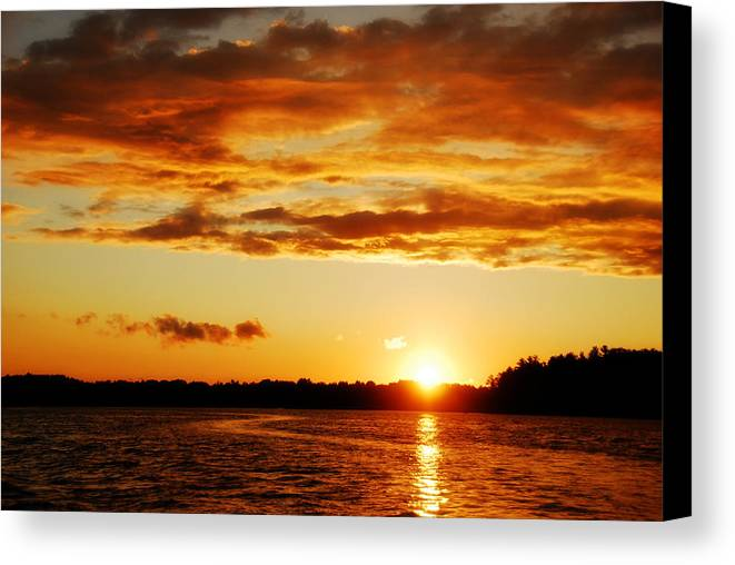 Sunset Canvas Print featuring the photograph Pretty Orange Sky by Madelin Zaycheck