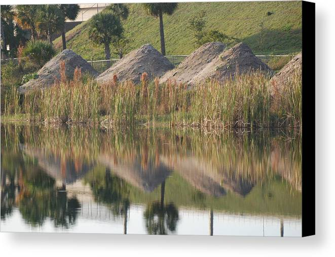 Grass Canvas Print featuring the photograph Pyrimids By The Lakeside Cache by Rob Hans