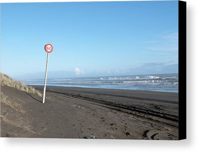 Speed Canvas Print featuring the photograph Speed Sign On The Ocean Beach by Yurix Sardinelly