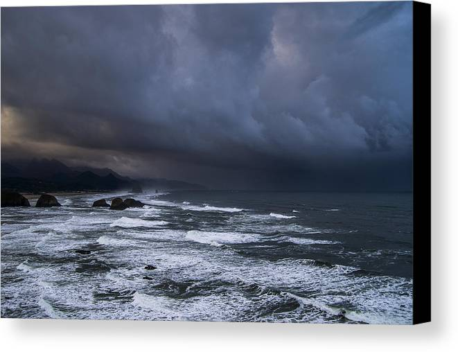 Cannon Beach Canvas Print featuring the photograph Storm Clouds by Robert Potts