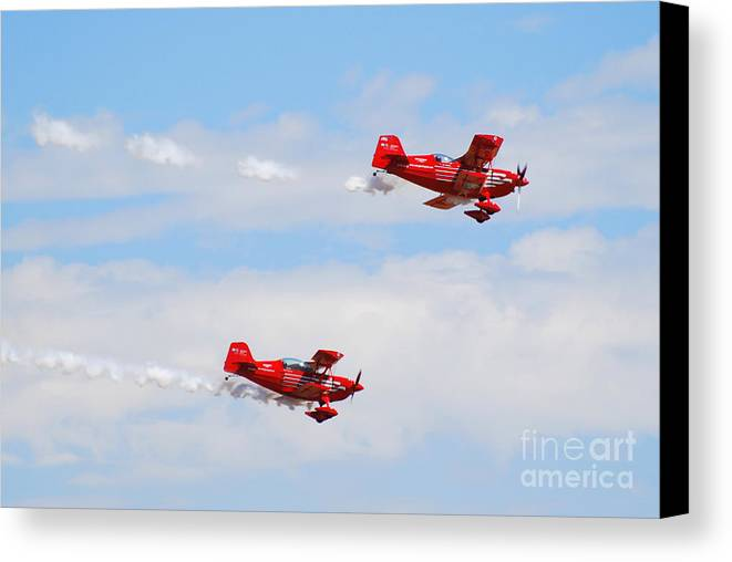 Stunts Canvas Print featuring the photograph Stunt Pilots by Larry Keahey
