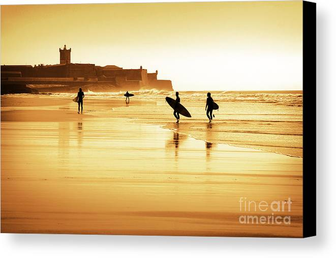 Action Canvas Print featuring the photograph Surfers Silhouettes by Carlos Caetano