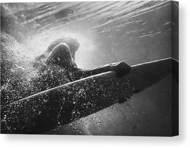 Underwater Canvas Print featuring the photograph A Woman On A Surfboard Under The Water by Ben Welsh