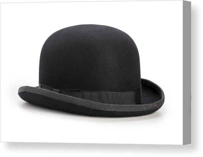 40f7b016c94 White Background Canvas Print featuring the photograph Black Bowler Hat  Isolated On A White Background by