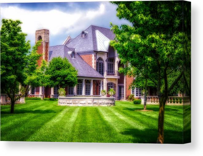 Donamire Horse Farm. Mansion. Home. House. Brick Home. Architecture. Trees. Landscape. Lawn. Grass. Fence. Stone Fence. Flowers. Shrubs. Cloudy Skies. Fireplace. Photography. Digital Art. Print. Canvas. Nature. Wildlife. Canvas Print featuring the photograph Donamire Farms by Mary Timman