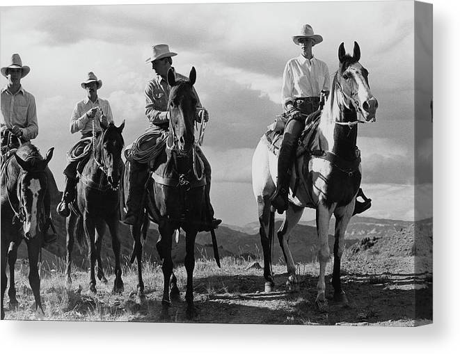 Animal Canvas Print featuring the photograph Male Models For The Gap Riding Horses by Arthur Elgort