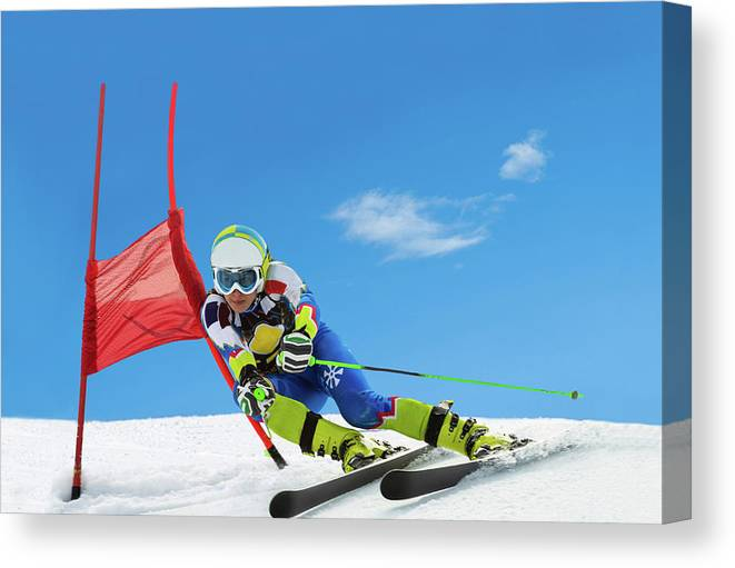 Ski Pole Canvas Print featuring the photograph Professional Female Ski Competitor At by Technotr