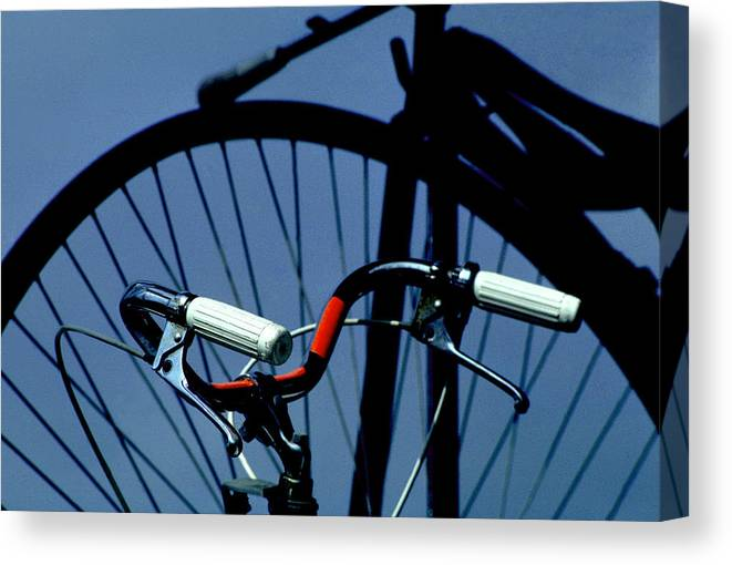 Cycles Canvas Print featuring the photograph Shadows Of The Past by Mike Flynn