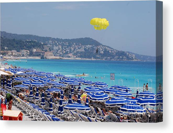 Nice Canvas Print featuring the photograph Flying Over The Nice Beach by Andrea Simon