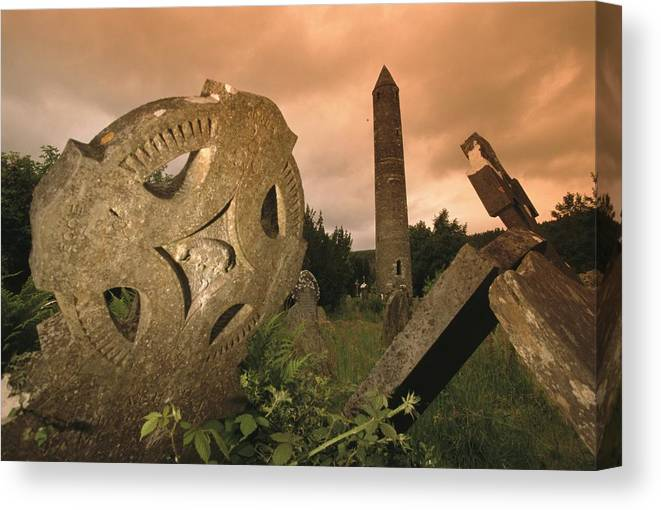 Europe Canvas Print featuring the photograph View Of The Round Tower And Gravestones by Richard Nowitz