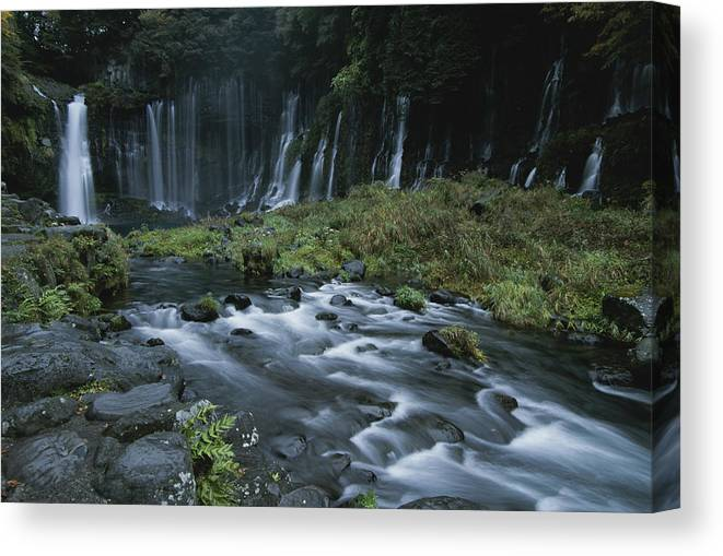 Asia Canvas Print featuring the photograph Water Falling And Flowing Over Rocks by Karen Kasmauski