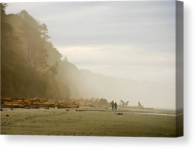 Washington State Olympic Peninsula Pacific Ocean Kalaloch Beach Beaches Seascape Seascapes Solitude Fog Foggy Couple Sand Water Driftwood Canvas Print featuring the photograph Couple On A Foggy Beach by Wilbur Young