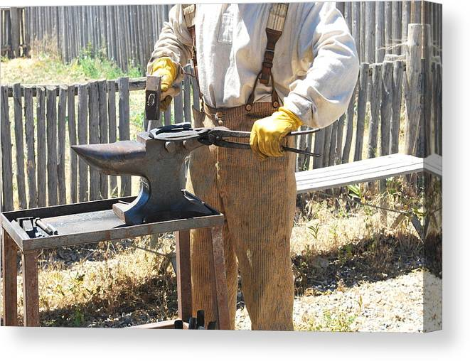 Man Canvas Print featuring the photograph Male Farrier. by Oscar Williams