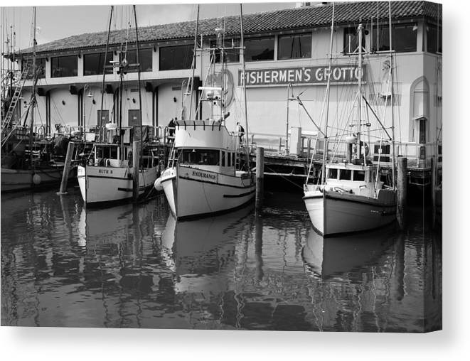 Water Canvas Print featuring the photograph Boats At The Dock by Brian Anderson