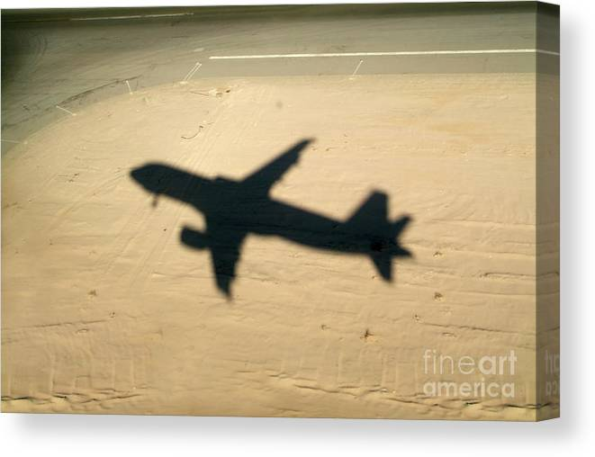 Aeroplane Canvas Print featuring the photograph Shadow Of Airplane Flying Into Land by Sami Sarkis