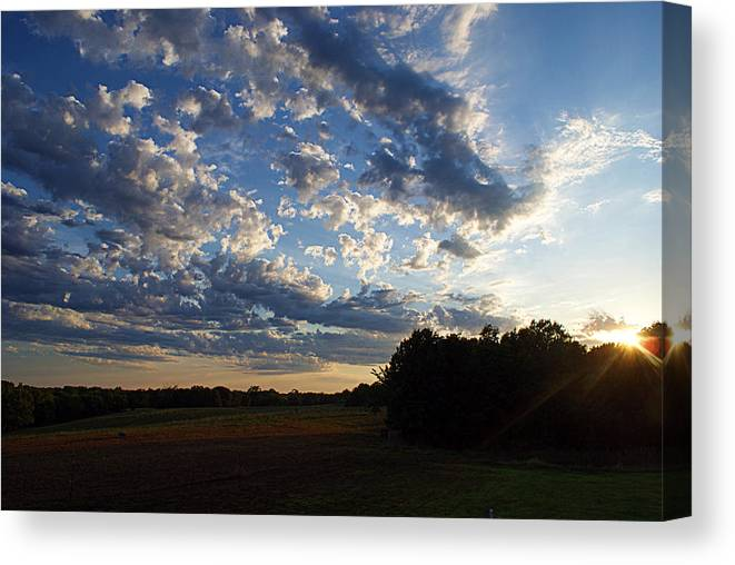 Clouds Canvas Print featuring the photograph Sunset After The Storm by Cricket Hackmann