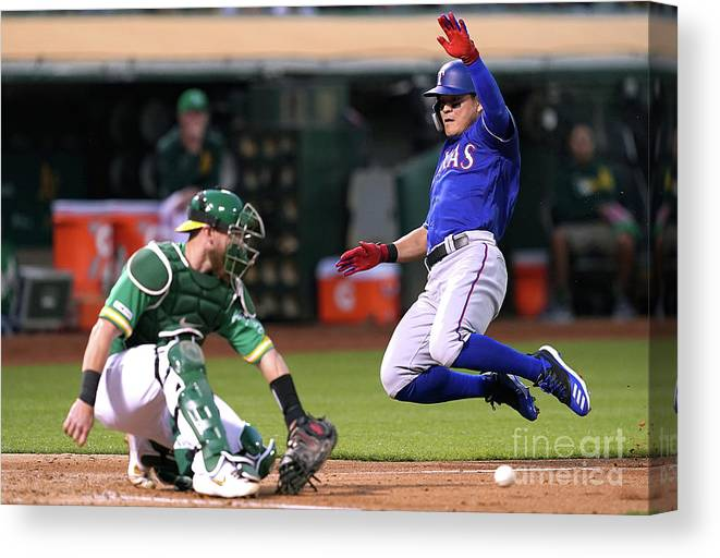Baseball Catcher Canvas Print featuring the photograph Texas Rangers V Oakland Athletics 14 by Thearon W. Henderson