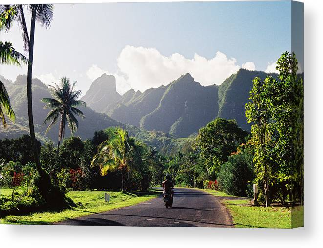 Shadow Canvas Print featuring the photograph Motorcyclist On Polynesian Road by Ejs9