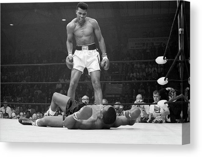 Heavyweight Canvas Print featuring the photograph Muhammad Ali Taunting Sonny Liston by Bettmann