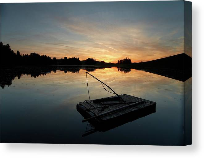 Scenics Canvas Print featuring the photograph Raft Floating On A Lake In Bavaria by Wingmar