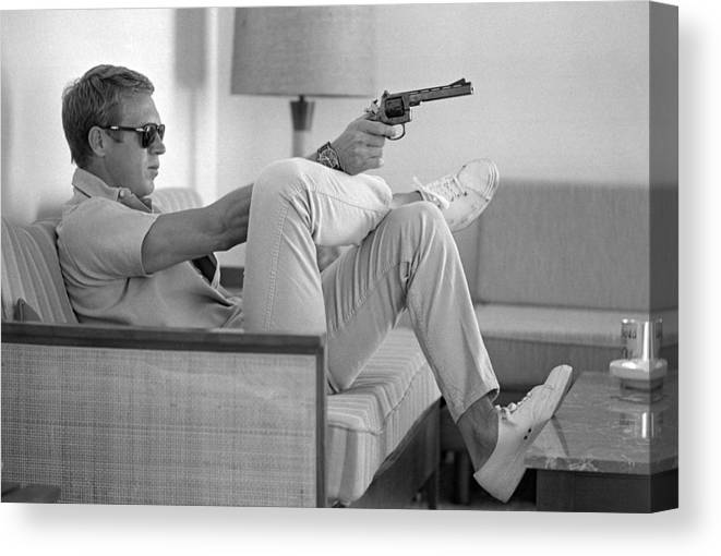 Timeincown Canvas Print featuring the photograph Steve Mcqueen Takes Aim by John Dominis