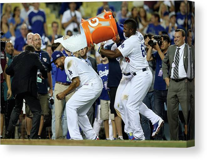 Game Two Canvas Print featuring the photograph Yasiel Puig And Matt Kemp by Stephen Dunn