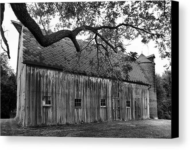 Old Barns Canvas Print featuring the photograph Barn With Brick Silo In Black And White by Julie Dant