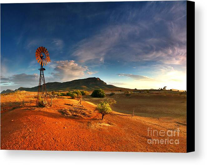 First Light Early Morning Windmill Dam Rawnsley Bluff Wilpena Pound Flinders Ranges South Australia Australian Landscape Landscapes Outback Red Earth Blue Sky Dry Arid Harsh Canvas Print featuring the photograph First Light On Wilpena Pound by Bill Robinson