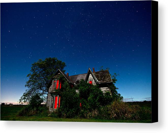 Abandoned Canvas Print featuring the photograph Haunted Farmhouse At Night by Cale Best