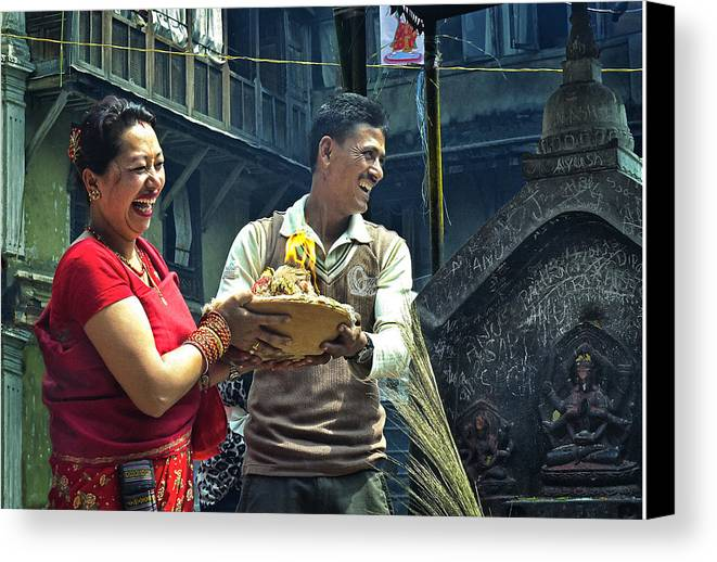 Happy Canvas Print featuring the photograph Laughing Couple Doing Puja by Karma Ganzler