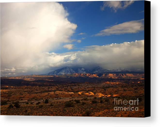 Storm Canvas Print featuring the photograph Storm Over The La Sals by Mike Dawson