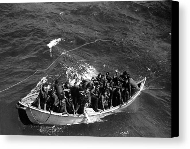 History Canvas Print featuring the photograph Survivors Of Uss Princeton In Life Boat by Everett