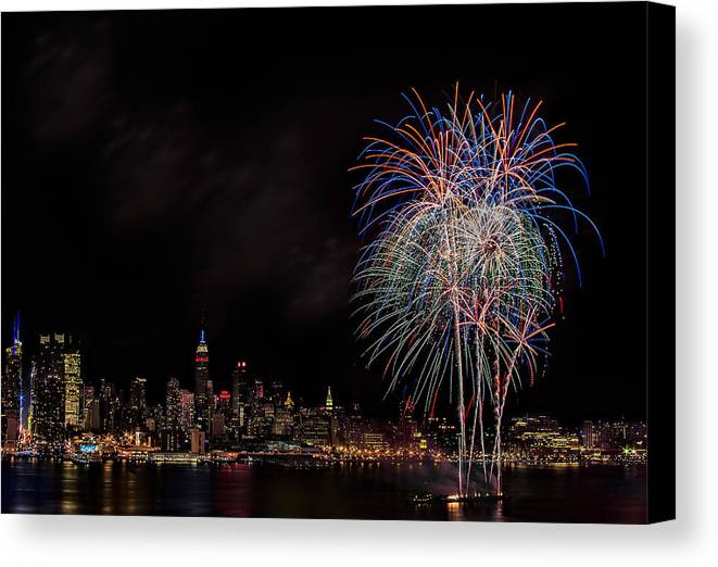 4th Of July Canvas Print featuring the photograph The New York City Skyline Sparkles by Susan Candelario