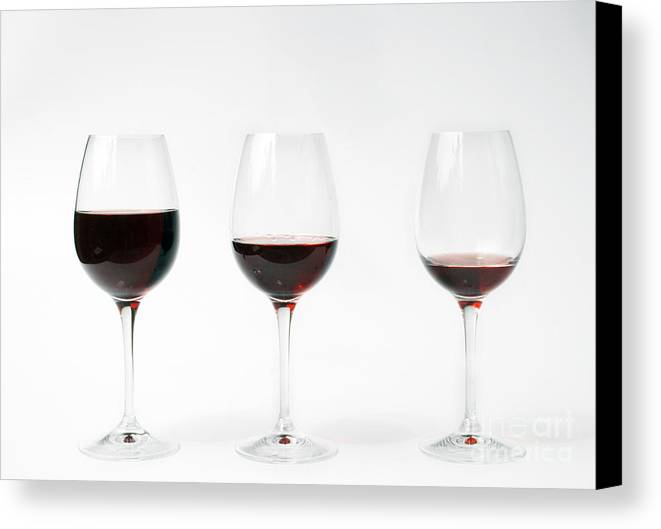 Three Canvas Print featuring the photograph Three Glasses Of Wine by Patricia Hofmeester