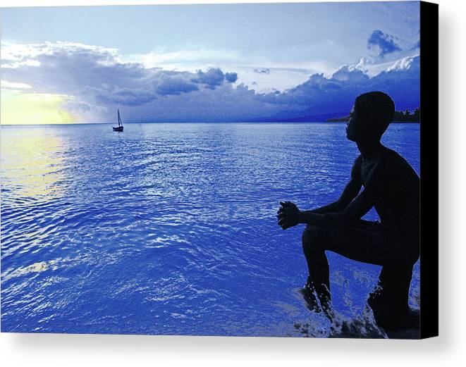 Sunset Canvas Print featuring the photograph Boy Sitting At Sunset by Johnny Sandaire