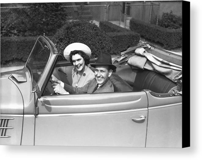 30-34 Years Canvas Print featuring the photograph Couple Riding In Old Fashion Convertible Car, (b&w),, Portrait by George Marks