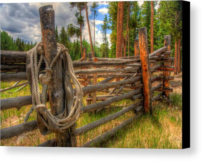 Mountains Canvas Print featuring the photograph Rope On Fence by Richard Saxon