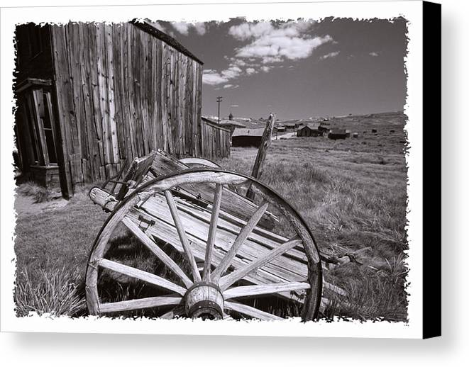 Black And White Canvas Print featuring the photograph Old Cart And Building Bodie California by George Oze