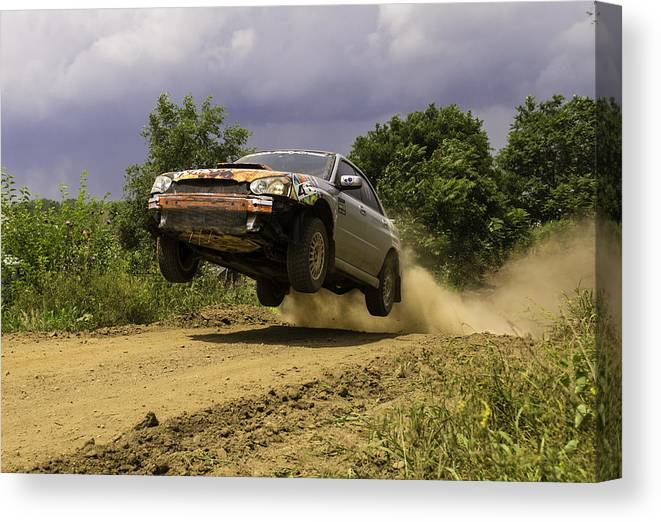 Dw Rally Team Canvas Print featuring the photograph Dw Rally Team Takes Flight by Jason Massey