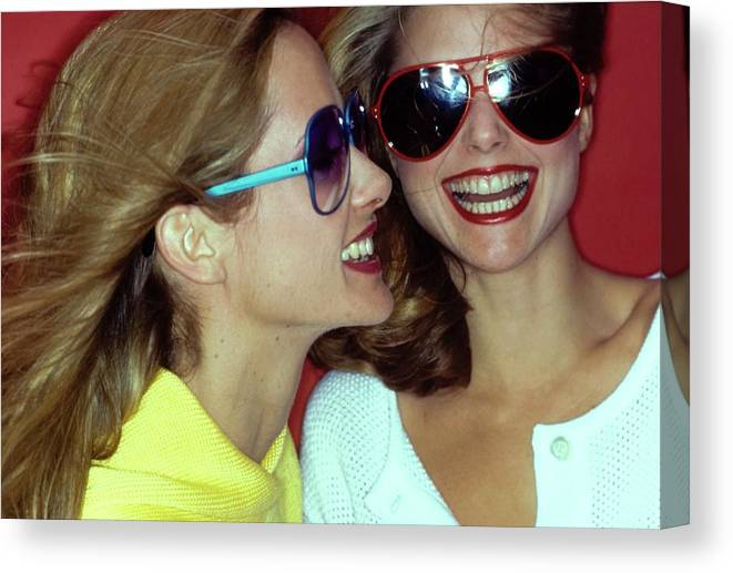 Beauty Canvas Print featuring the photograph Models Wearing Sunglasses by Jacques Malignon