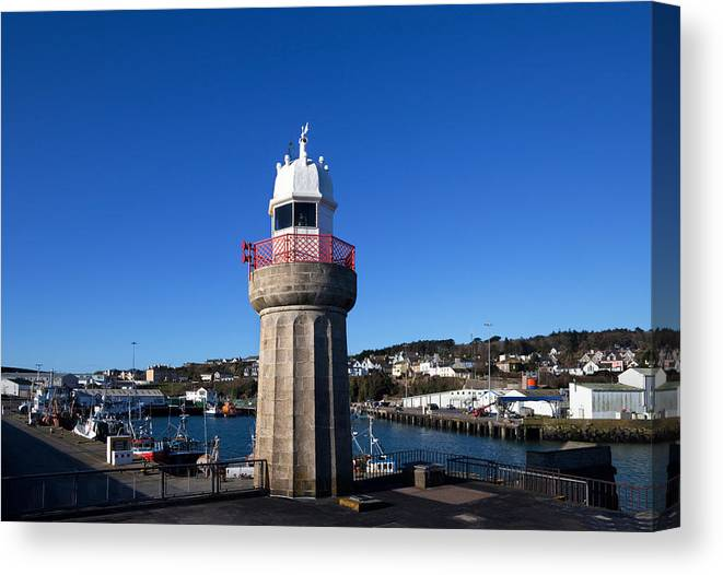 Photography Canvas Print featuring the photograph The Lighthouse And Fishing Harbour by Panoramic Images
