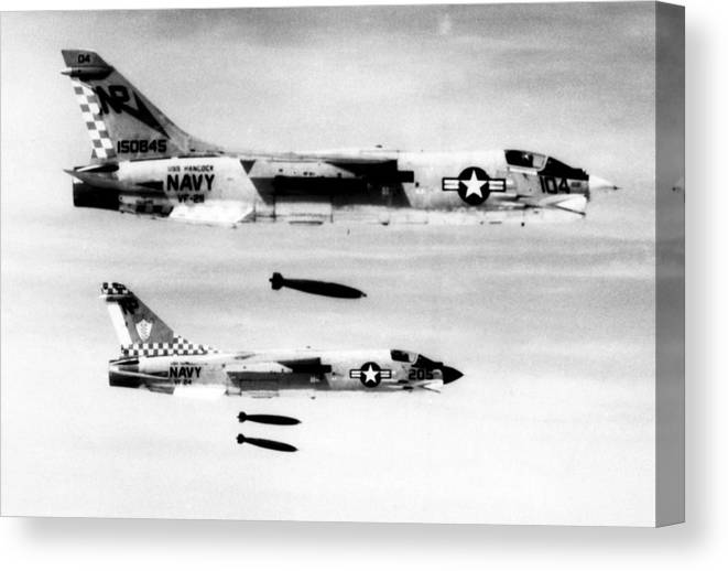 1970s Candids Canvas Print featuring the photograph F-8 Aircraft Release Bombs On North by Everett