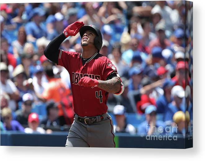 Three Quarter Length Canvas Print featuring the photograph Arizona Diamondbacks V Toronto Blue Jays by Tom Szczerbowski