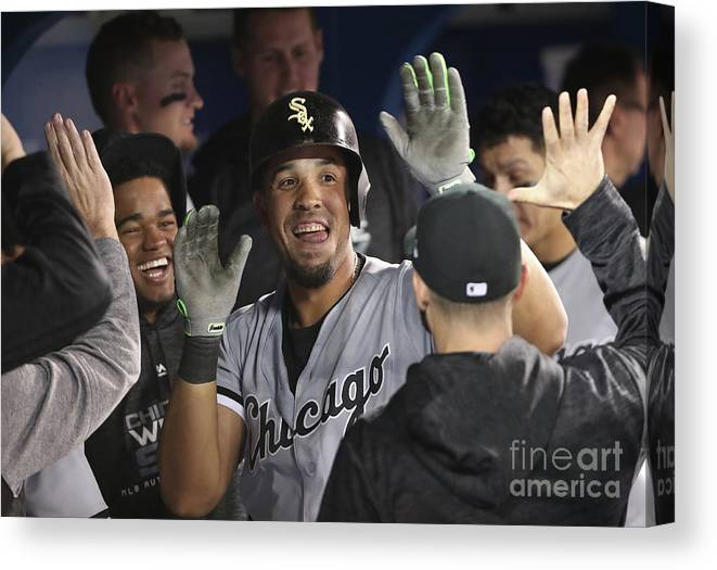People Canvas Print featuring the photograph Chicago White Sox V Toronto Blue Jays by Tom Szczerbowski