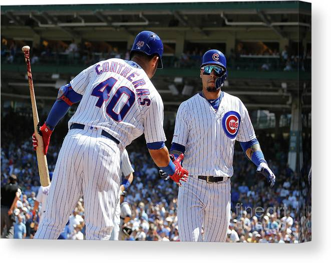 Following Canvas Print featuring the photograph Milwaukee Brewers V Chicago Cubs 2 by Nuccio Dinuzzo